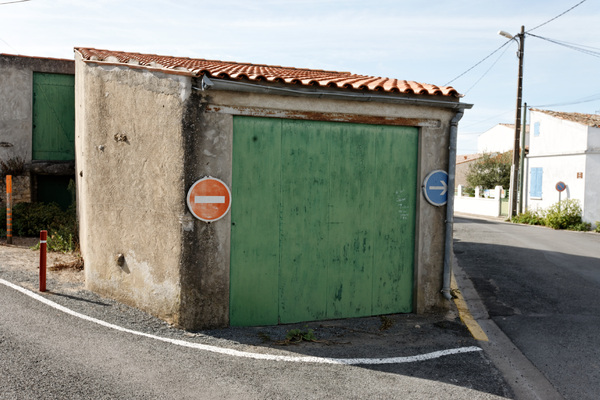 One  parks in the junction. Not besides, on or by, no: in. 