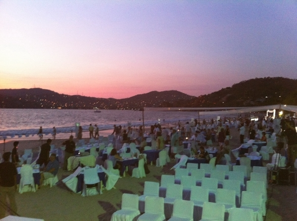 Setting up for my second demo at Food&Wine Festival In Zihuatenejo.  Right on the beach at sunset!