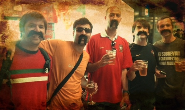 Big  moustaches are popular with the Portugal fans heading to #euro2012 partners w Dutch in group of death