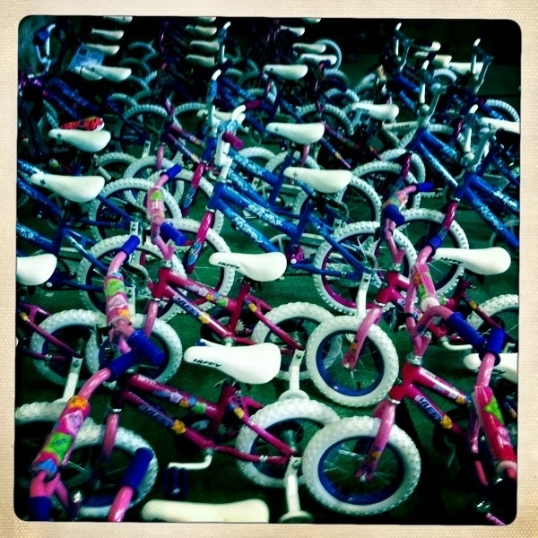 Kids are finally arriving, we got about 90 bicycles to give away! They have the biggest smiles!!! Merry Xmas kids!
