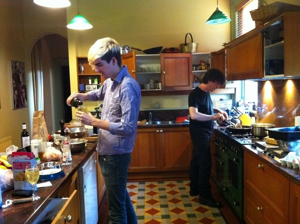 luke pours hard cider. @neilhimself is frying potato latkes. christmas is afoot in the Nicholls-Coney household.