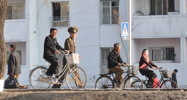 Rare sight: woman on a bicycle (in P'yŏngsŏng). Women in Pyongyang not allowed to bike, drive or smoke.  #NKorea