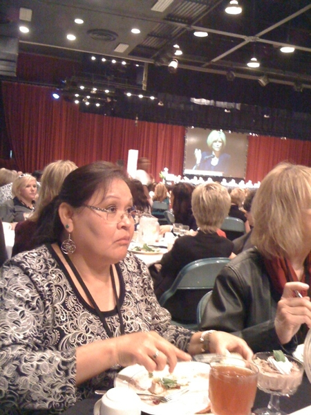 Marlene with Joan Lunden in the background  @ The Bakersfield Business Conf.