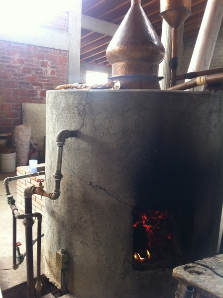 Fidencio Mezcal Distlry, Oax: small copper still distillation of fermented agave.