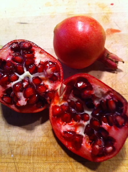 After 6 years, my dwarf pomegranate produced fully formed fruit!  Used to decorate pear cake.