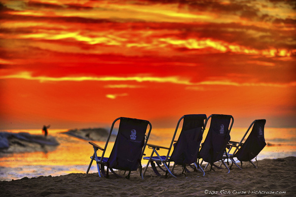 Beach chairs from the @RitzCarlton Laguna Niguel at Salt Creek Beach at sunset with a surfer!  @VisitCA