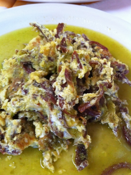 Carmelita's:  aporreadillo of shredded dried beef scrabbled w eggs; brothy tomatillo sauce