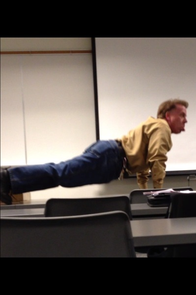 My speech instructor doin pushups in class on the table wtf?